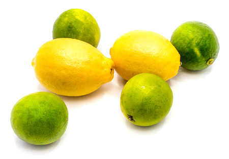 Group of several whole lemons and limes isolated on white background