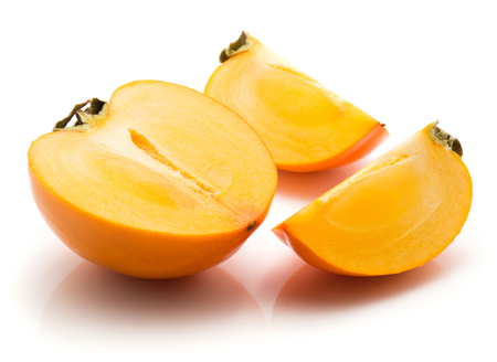Sliced persimmon Kaki isolated on white background one half two slices quarter