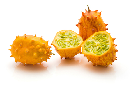 Kiwano isolated on white background two whole and one cut in half  Stock Photo