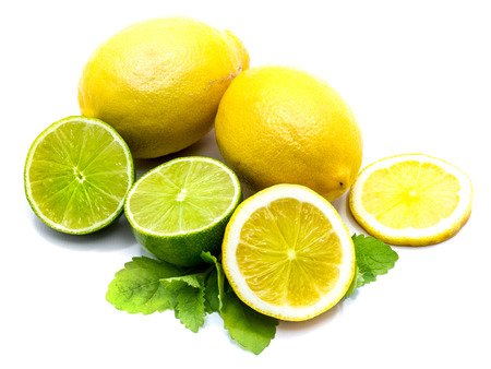 Two whole and sliced yellow lemon with lime halves isolated on white studio background