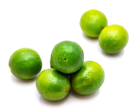 Group of whole green lime isolated on white background  Stock Photo