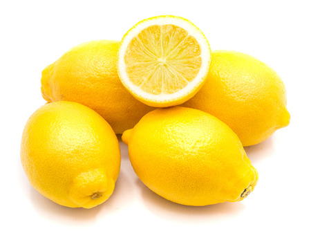 Group of whole yellow lemons and one half isolated on white background