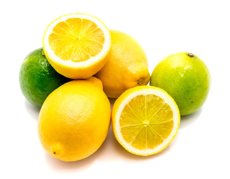 Citrus. Two whole limes, lemons and its halves isolated on white background