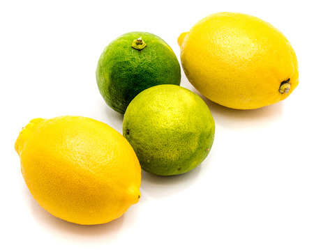 Group of pair whole lemon and limes isolated on white background