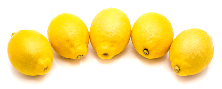 Group of several whole yellow lemonsin row isolated on white background   Stock Photo