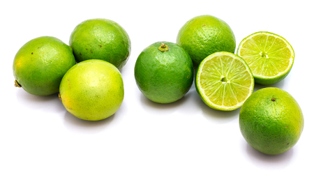 Group of whole and lime halves isolated on white studio background