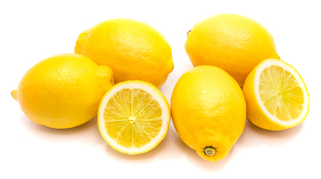 Group of whole yellow lemons and two halves isolated on white background