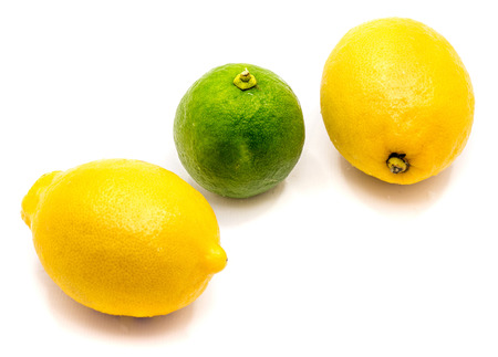 One whole lime and two lemons isolated on white background