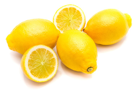 Group of three whole yellow lemons and two halves isolated on white background  Stock Photo