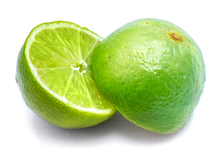 Two lime halves, sliced, isolated on white studio background