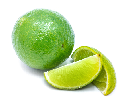 One whole lime and two lime slices isolated on white background