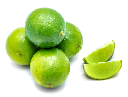 Group of whole green lime and two slices isolated on white background