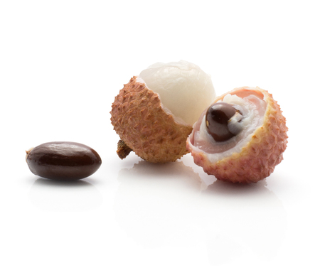 Lychee stack isolated on white background ripe pink fresh two berries peel with chicken tongue seeds