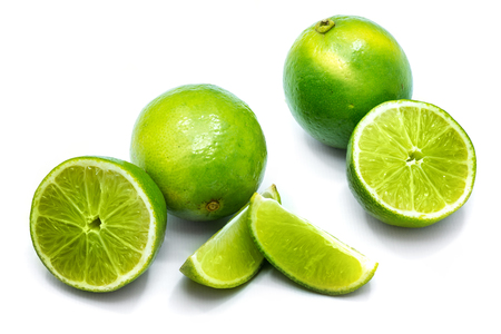 Group of whole, sliced lime and halves isolated on white background Stock Photo