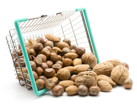 Nuts mix (walnut, hazelnut and almond) out a shopping basket isolated on white background