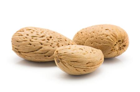 Three unshelled almonds isolated on white background  Stock Photo