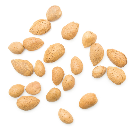Unshelled almonds top view isolated on white background a lot of whole