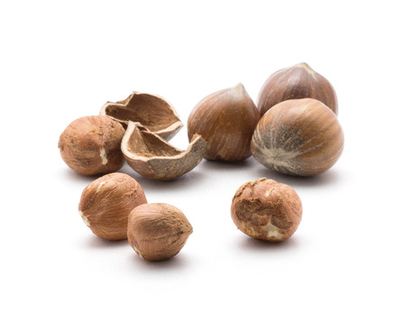 Hazelnuts isolated on white background group of brown shelled and unshelled nuts  Stock Photo
