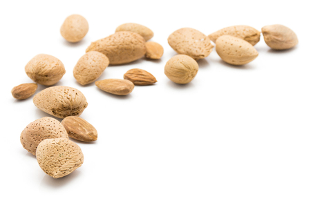 Raw almonds isolated on white background