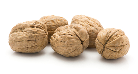 Unshelled walnuts isolated on white background five whole