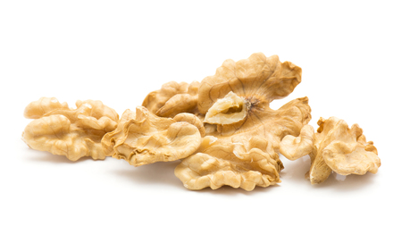 Shelled walnuts stack isolated on white background