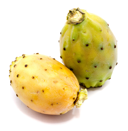 Two whole prickly pears, orange and green yellow isolated on white background