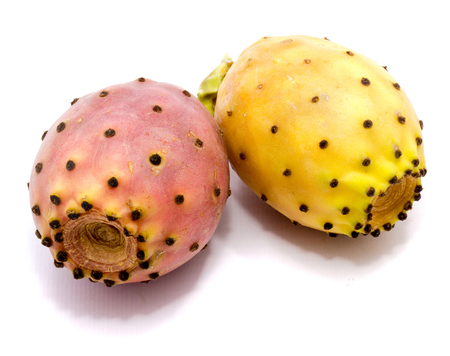 Two whole prickly pears, orange and red isolated on white background Stock Photo