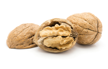 Walnuts isolated on white background one unshelled and one open with nutmeat  写真素材