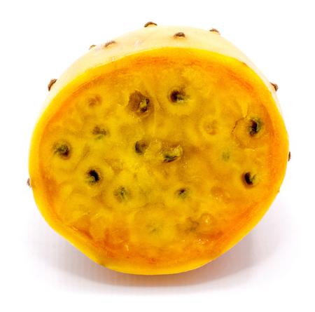Sliced opuntia orange flesh with seeds, one half, isolated on white background Archivio Fotografico