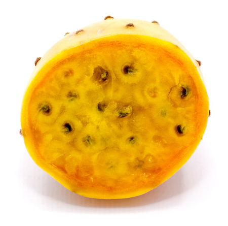 Sliced opuntia orange flesh with seeds, one half, isolated on white background Stok Fotoğraf