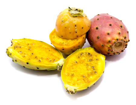 Sliced four yellow and orange prickly pear halves, one whole pink, isolated on white background  Stock Photo