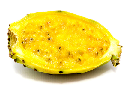 One yellow green prickly pear half with seeds isolated on white background