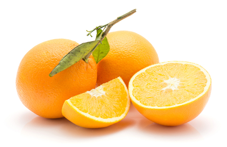 Oranges isolated on white background two whole with green leaf one half one sliced quarter