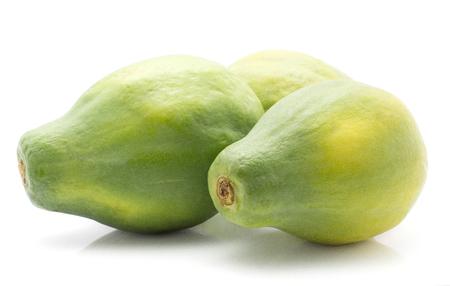 Three green papaya (pawpaw, papaw) isolated on white background fresh