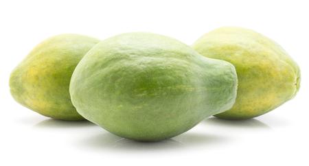 Three green papaya (pawpaw, papaw) isolated on white background fresh whole