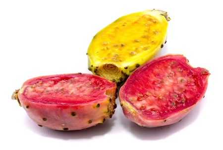 Sliced one yellow green and two pink prickly pear halves of isolated on white background 스톡 콘텐츠