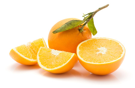 Sliced oranges isolated on white background one whole with green leaf one half two quarters