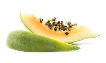 Two green papaya (pawpaw, papaw) slices isolated on white background