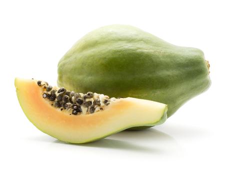 Green papaya (pawpaw, papaw) one whole one slice with seeds isolated on white background