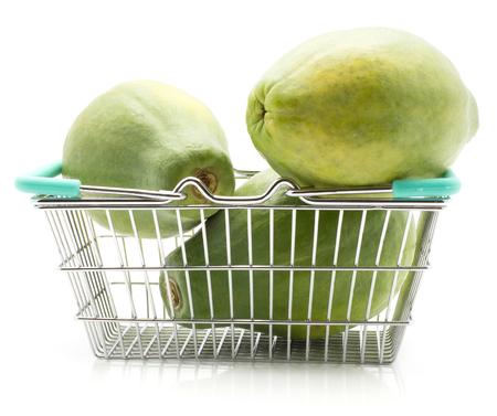 Green papaya (pawpaw, papaw) in a shopping basket isolated on white background  Stock Photo