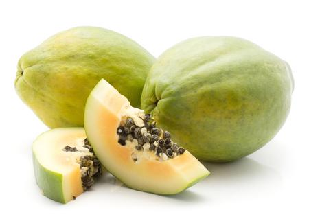 Green papaya (pawpaw, papaw) isolated on white background two whole and two slices orange flesh with seeds