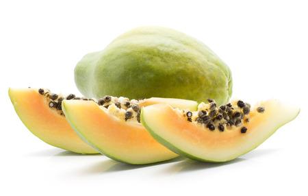 Green papaya (pawpaw, papaw) one whole three slices with seeds isolated on white background