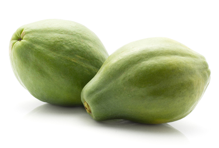 Two green papaya (pawpaw, papaw) isolated on white background
