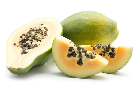 Green papaya (pawpaw, papaw) one whole one half and two slices with seeds isolated on white background Stock Photo