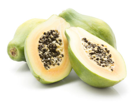 Papaya (pawpaw, papaw) stack isolated on white background two whole green and one cut in half with seeds
