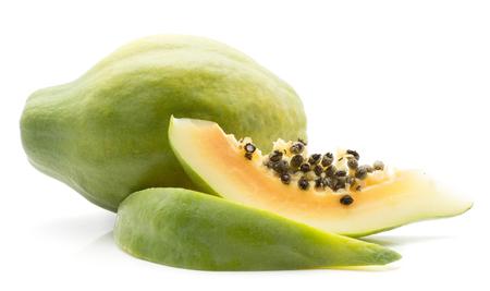 Green papaya (pawpaw, papaw) one whole two slices isolated on white background  Stock Photo