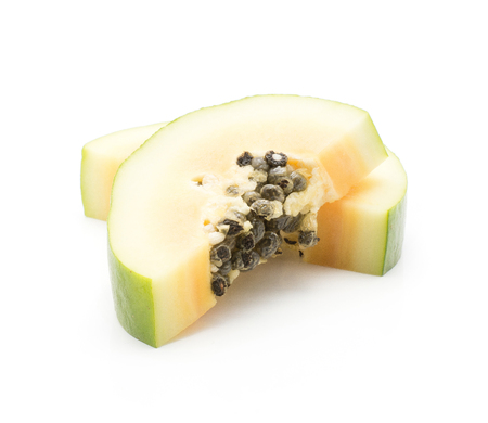 Two green papaya slices (pawpaw, papaw) isolated on white background Stock Photo