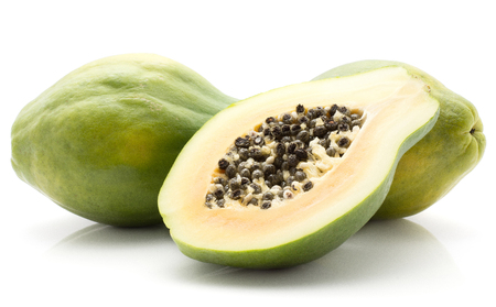 Papaya (pawpaw, papaw) isolated on white background two whole green and cross section half with seeds