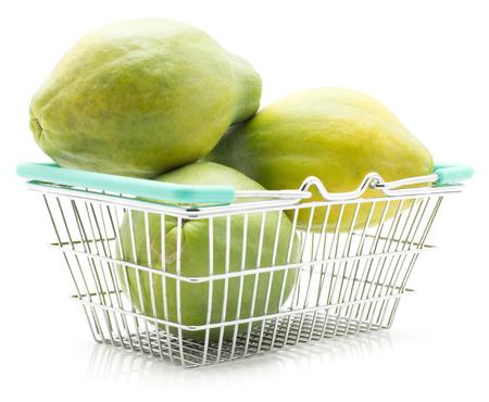 Green papaya (pawpaw, papaw) in a shopping basket isolated on white background three fresh