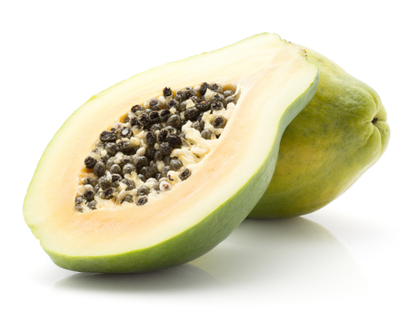 Papaya (pawpaw, papaw) isolated on white background one whole green cross section half with seeds